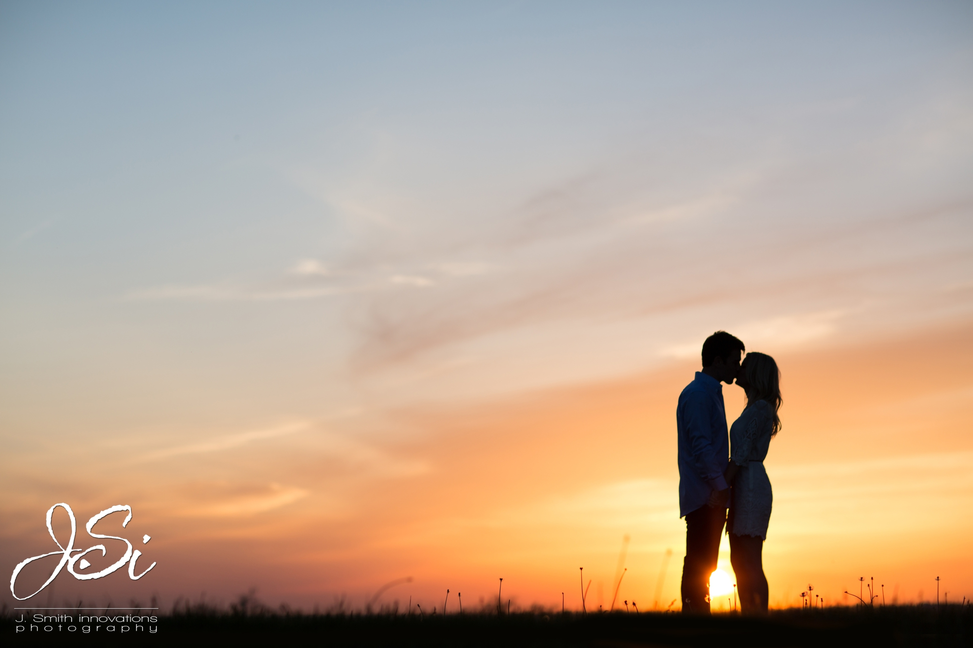KC Wedding Photographers sunset silhouette picture engagement session picture