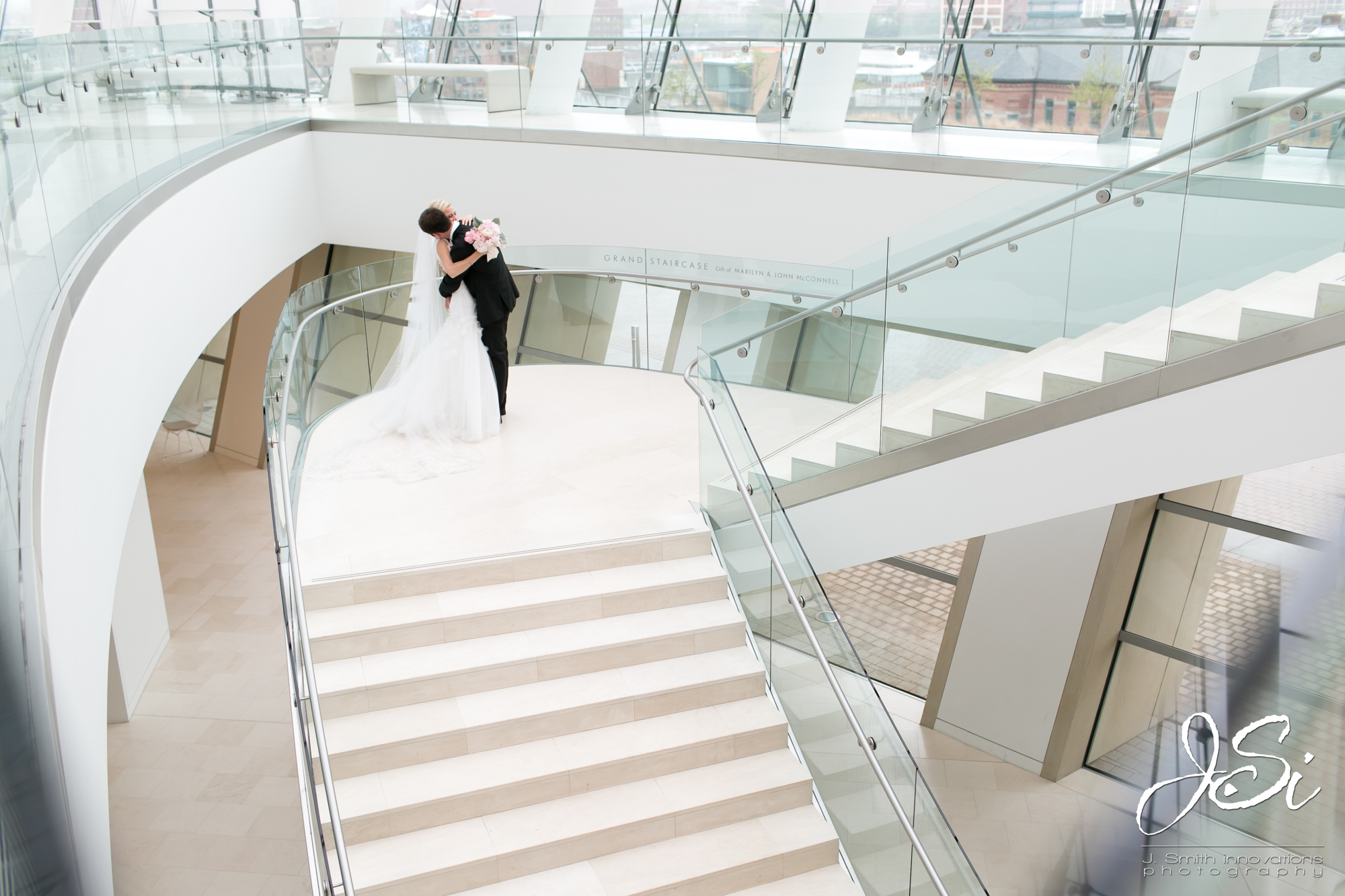 Kansas City Kauffman Center for the Performing Arts wedding first look husband wife photographer team photo