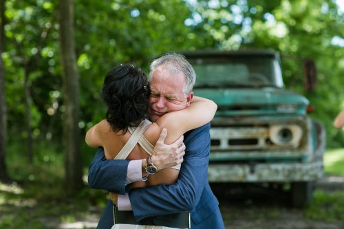 KC destination photographer heartfelt hug father of bride crying real candid moment photo gallery