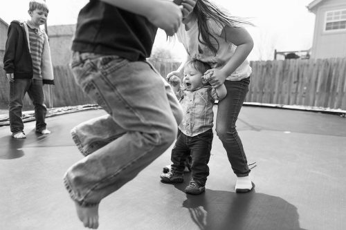 KC documentary family photographers photo of kids jumping on trampoline