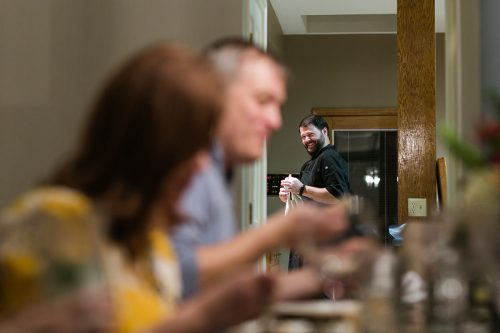 Kansas City documentary photographers birthday dinner chef smiling authentic moment picture