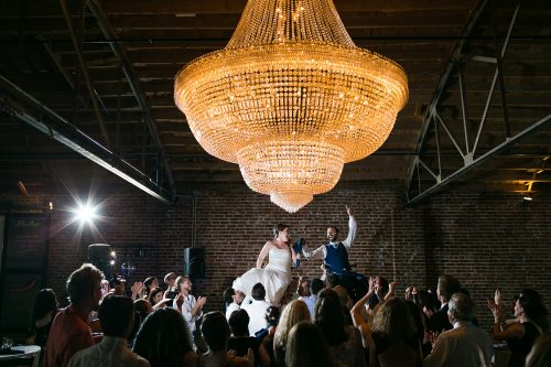 big chandelier Jewish Hora chair dance epic photo