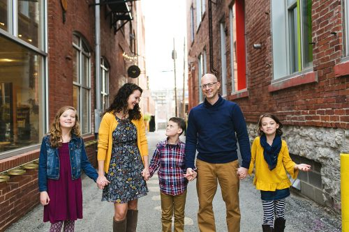 cute family photo of beautiful family in urban alley during laid back photography session