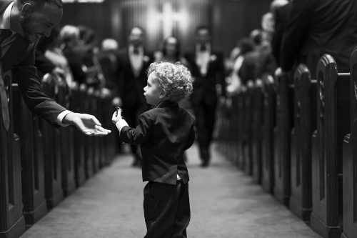 cute ring bearer stopping in aisle