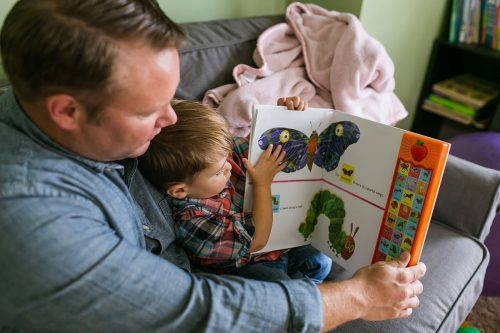 dad reading to son real moment