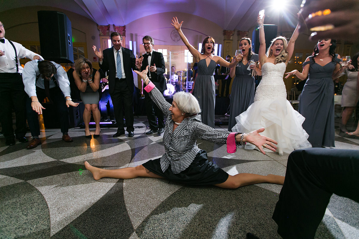 destination photographer epic wedding reception picture of lady doing splits fun moment gallery