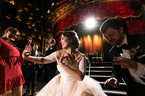 destination wedding photographers epic reception bride dancing