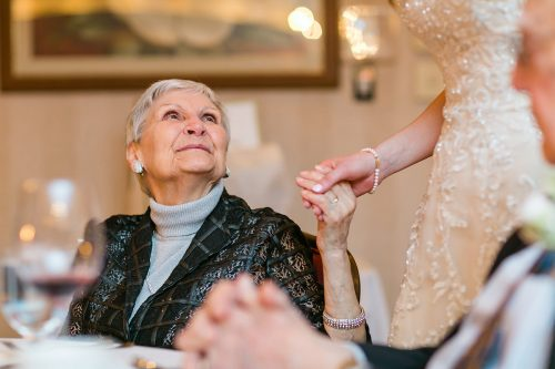 documentary photo of grandma holding brides hand gallery