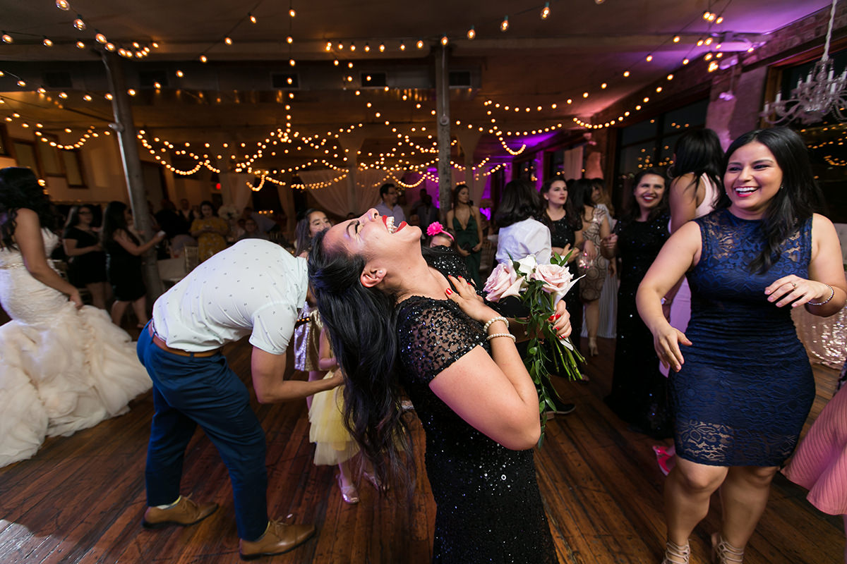 excited bouquet toss real moment story wedding reception photo gallery