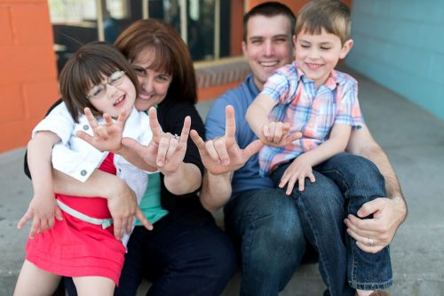 fun family photo making I love you sign language
