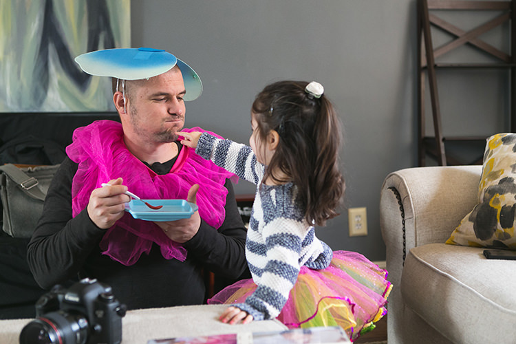 fun family photographers dressing up silly for kid