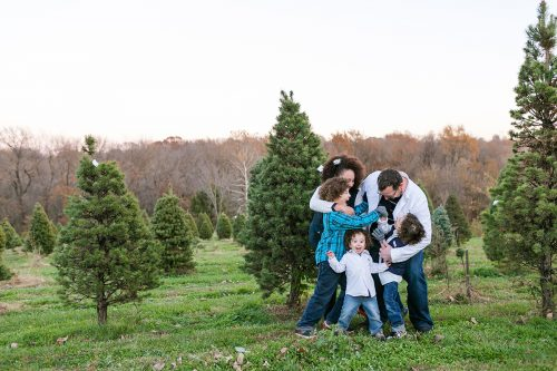 fun family pictues at Christmas tree farm real moment