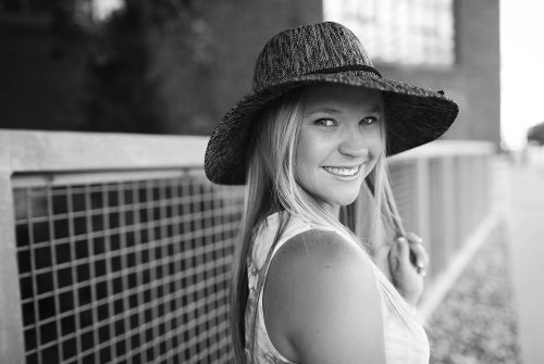 fun high school senior with hat