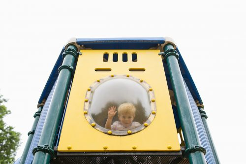 fun photo of kid in playground bubble