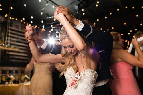fun playful wedding reception dancing