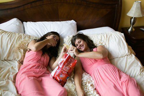 genuine bridesmaid moment eating chips in bed real unposed photo gallery