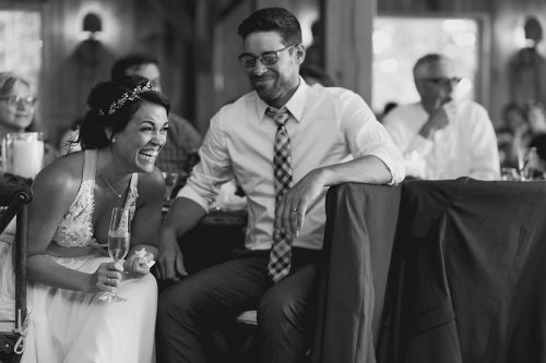 genuine happy emotion during toast candid wedding photography