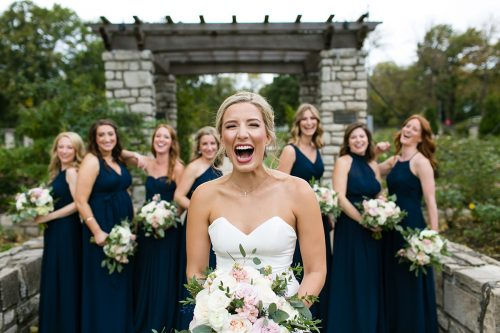 genuine laughing expression on bride during bridal party portraits