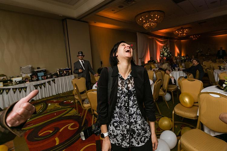 genuine laughing wedding photographer photo