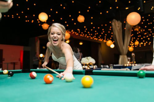 genuine moment laid back bride playing pool storytelling picture