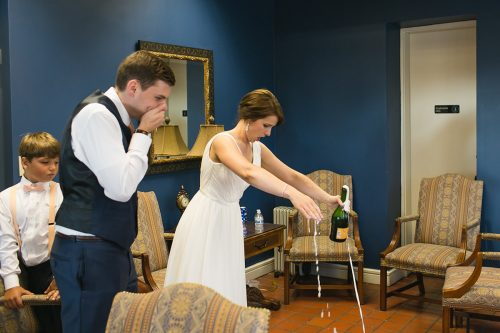 genuine photo of bride spilling champagne bubble over storytelling picture