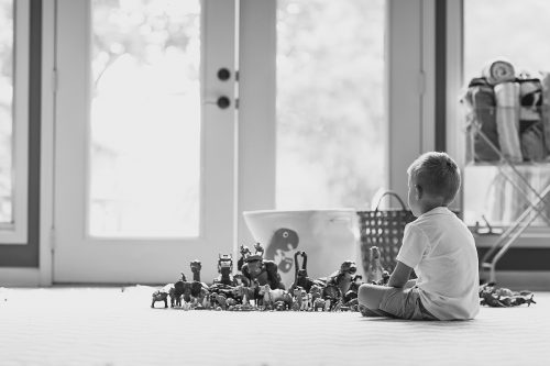 genuine story moment of boy and his dinosaurs lined up photo