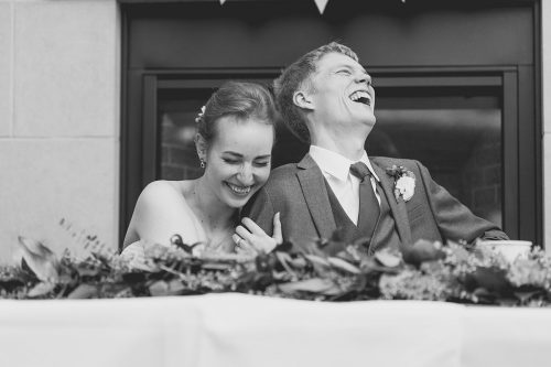 happy big laughing bride groom candid photo