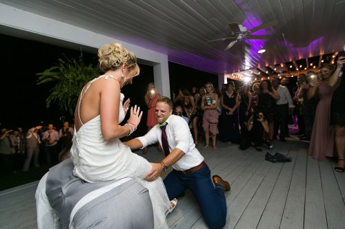 hilarious groom getting garter moment