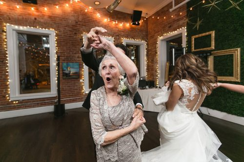 husband wife photographers grandma twirling on dance floor moment photo