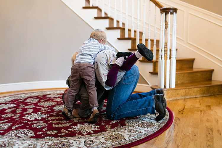 real moment kids dogpile on family photographer