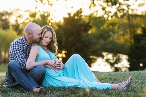 relaxed genuine loving moment during maternity session photo