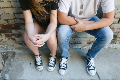 senior boy and girlfriend fun relationship photo with Chucks