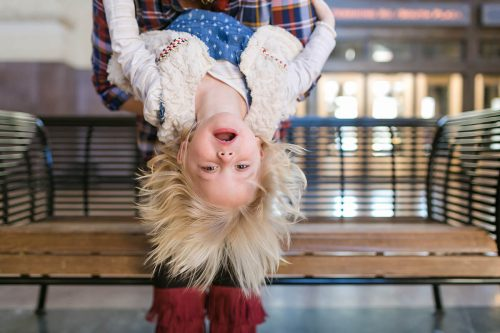 silly fun picture of girl upside down Kansas City kid photographer
