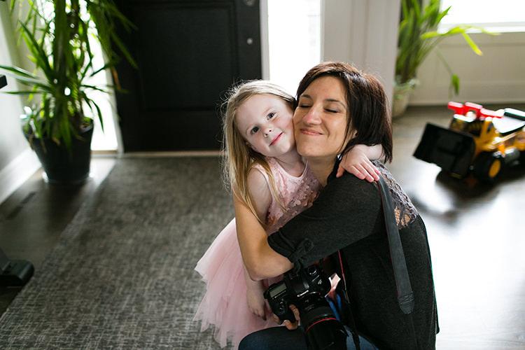 sweet girl hugging documentary storyteller photographer
