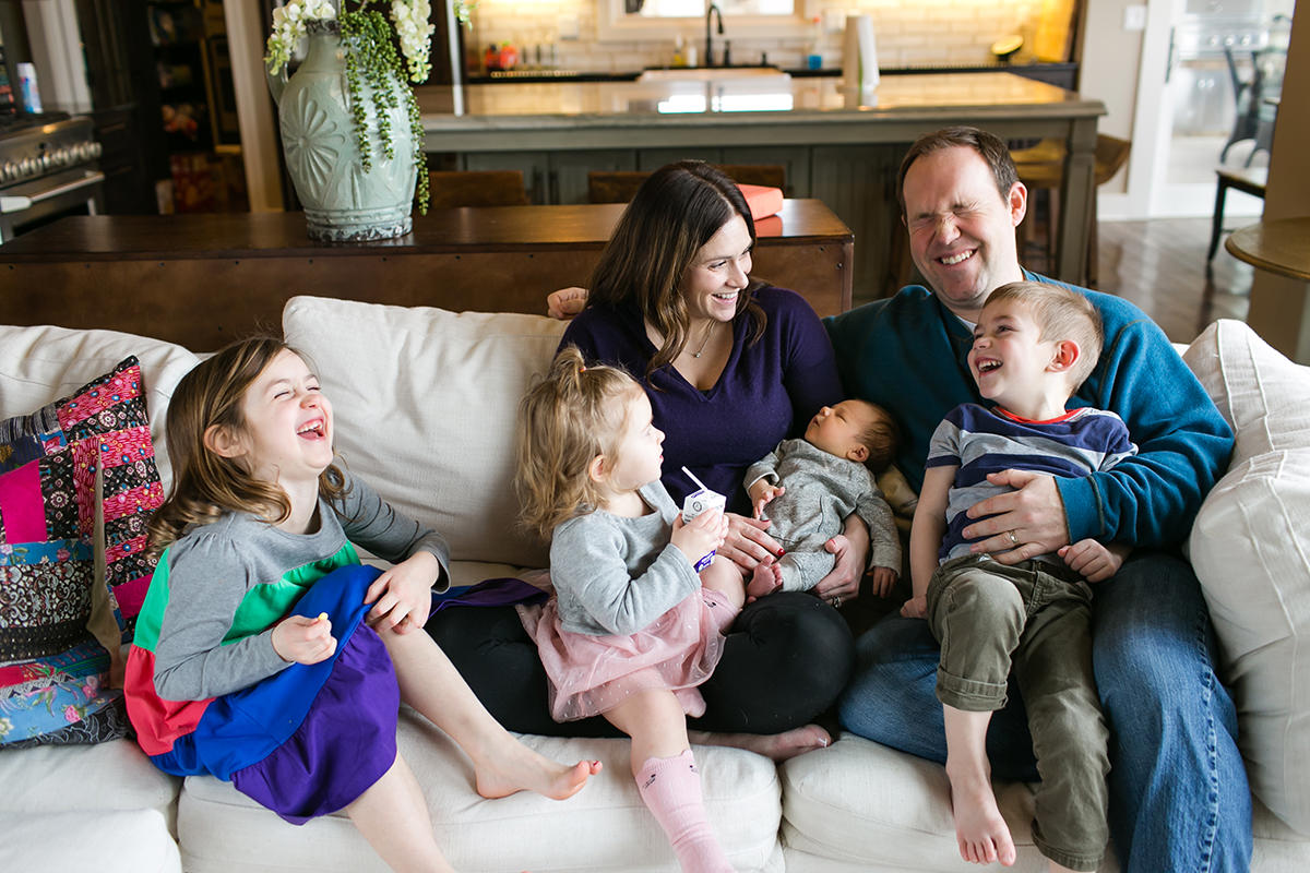 KC genuine happy laughing family during real moment during newborn session
