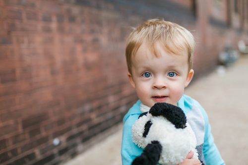 cute kid with stuffed animal at relaxed kid's photo session