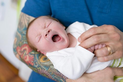 genuine real moment of baby yawning during photoshoot