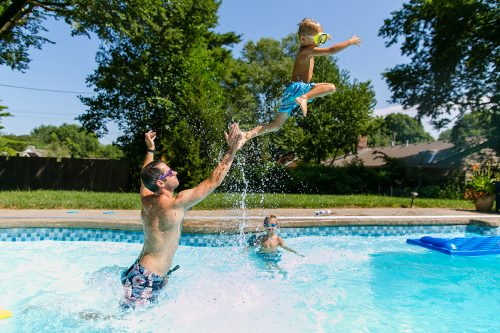 The UNportrait Experience fun photo of dad throwing kid in pool picture