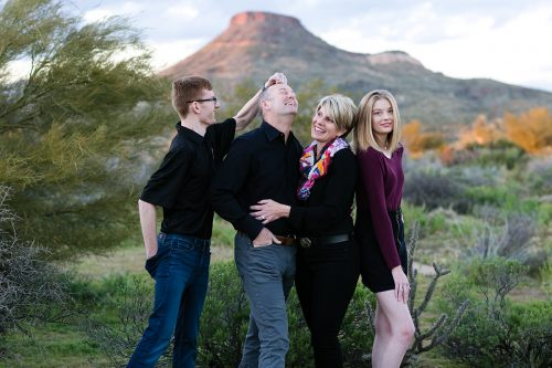 fun silly family picture in desert with mountain in Arizona photo