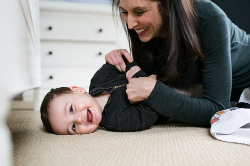genuine laughter of mom and son during meaningful in home family photo session