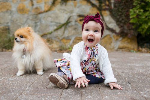 genuinely happy kid with real smile and puppy laid back family pictures