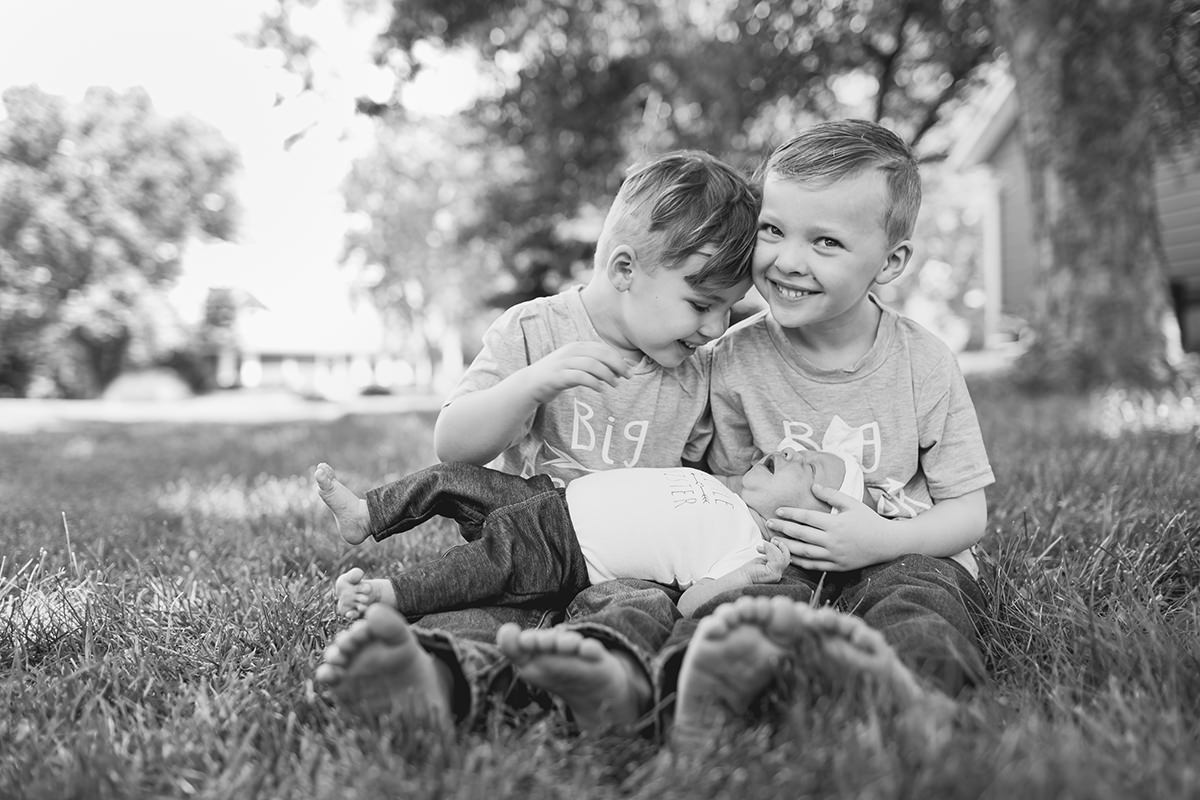 sweet boys holding baby sister photo