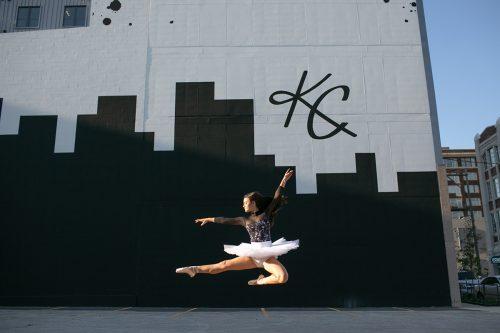pas de chat in front of KC mural dancer picture